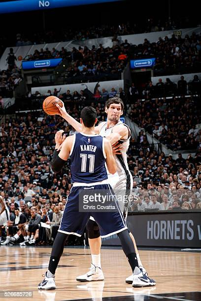 Boban Marjanovic of the San Antonio Spurs handles the ball during the game against Enes Kanter of the Oklahoma City Thunder in Game One of the...