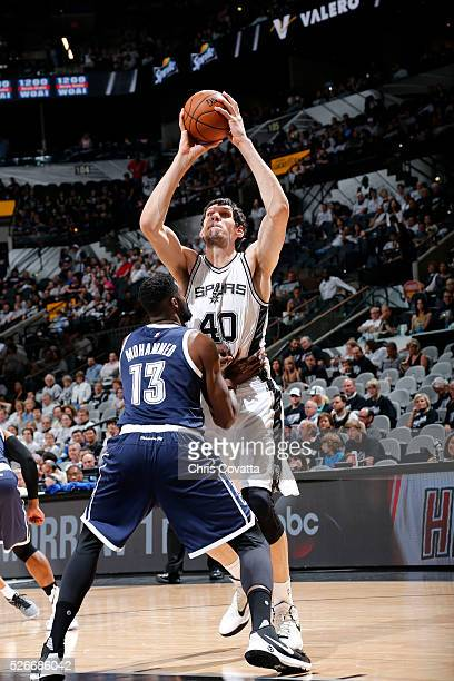 Boban Marjanovic of the San Antonio Spurs handles the ball during the game against Nazr Mohammed of the Oklahoma City Thunder in Game One of the...