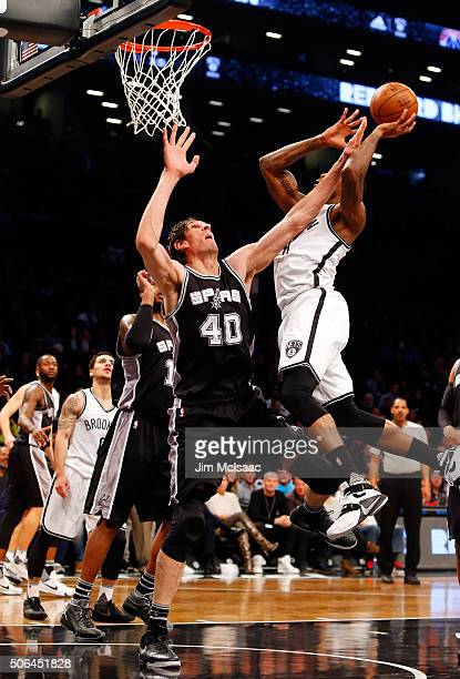 Boban Marjanovic of the San Antonio Spurs in action against the Brooklyn Nets at Barclays Center on January 11 2016 in the Brooklyn borough of New...