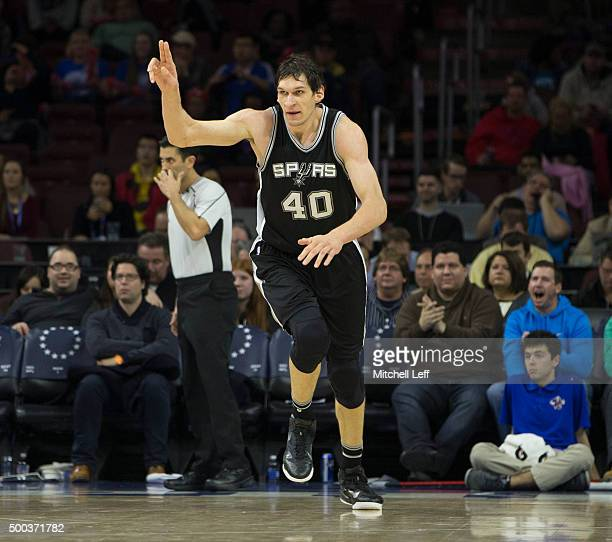 Boban Marjanovic of the San Antonio Spurs reacts after a made basket in the game against the Philadelphia 76ers on December 7 2015 at the Wells Fargo...