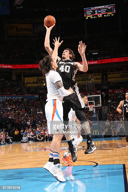 Boban Marjanovic of the San Antonio Spurs shooots against the Oklahoma City Thunder during the game on March 26 2016 at Chesapeake Energy Arena in...