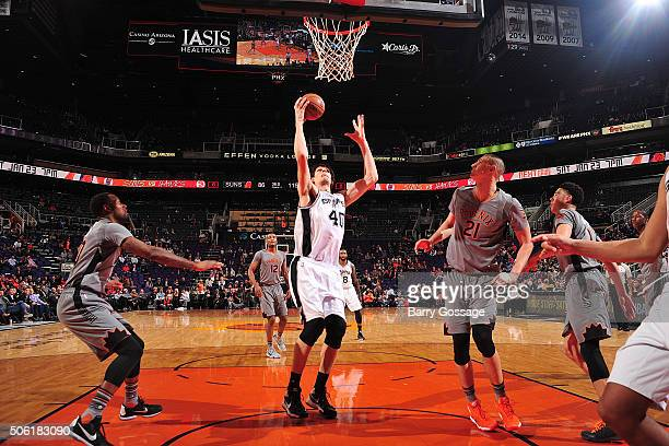 Boban Marjanovic of the San Antonio Spurs shoots the ball against the Phoenix Suns on January 21 2016 at Talking Stick Resort Arena in Phoenix...