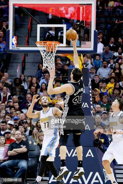 Boban Marjanovic of the San Antonio Spurs shoots the ball during the game against the Denver Nuggets on April 08 2016 at the Pepsi Center in Denver...