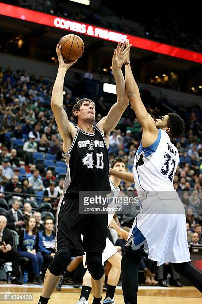 Boban Marjanovic of the San Antonio Spurs shoots the ball during the game against the Minnesota Timberwolves on March 8 2016 at Target Center in...