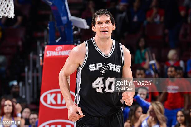 Boban Marjanovic of the San Antonio Spurs smiles and runs up court against the Philadelphia 76ers at the Wells Fargo Center on December 7 2015 in...