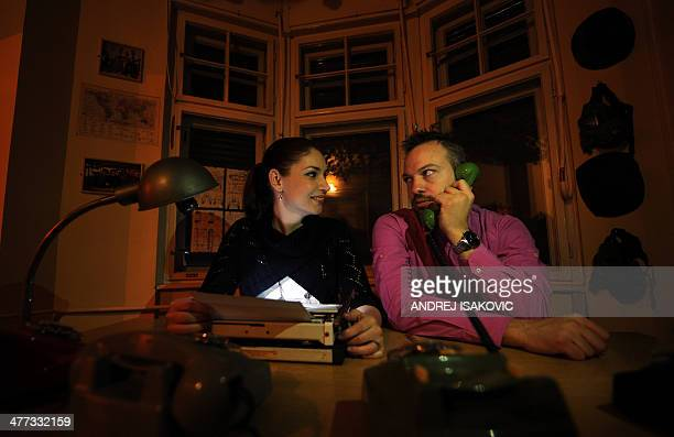 """Boban Melkus and his wife Nina, managers of the virtual """"Escape Room"""" game, pose for a picture in Novi Sad, on January 31, 2014. Those fed up with..."""