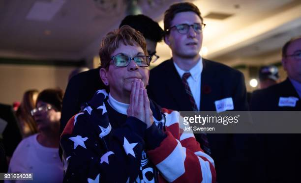 Bobbi Bauer prays for her candidate while watching election results at an Election Night event for GOP PA Congressional Candidate Rick Saccone as the...