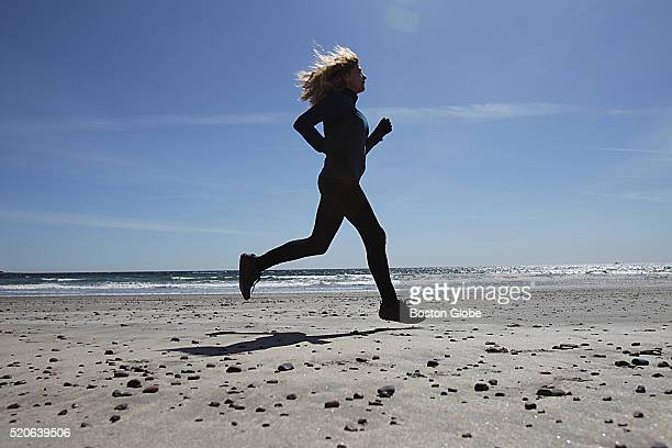 Bobbi Gibb the first woman to complete the Boston Marathon 50 years ago runs on the beach in Rockport Mass on March 30 2016 She is the MC of the...