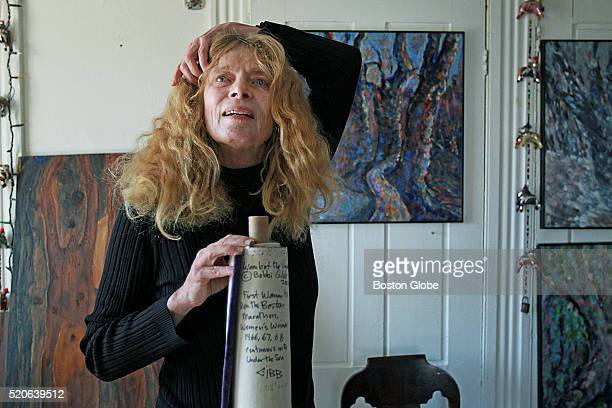 Bobbi Gibb the first woman to complete the Boston Marathon 50 years ago with her paintings at her home in Rockport Mass on March 30 2016 She signs...