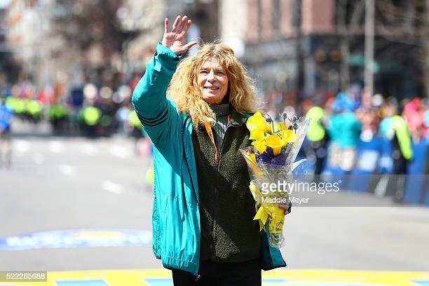 Bobbi Gibb the first woman to run the Boston Marathon crosses the finish line during the 120th Boston Marathon on April 18 2016 in Boston...