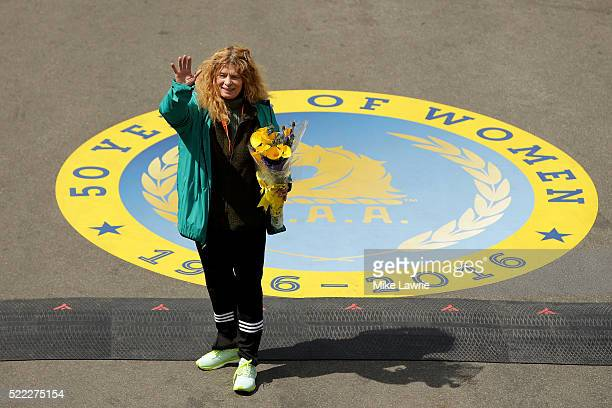 Bobbi Gibb the first woman to run the Boston Marathon poses after crossing the finish line during the 120th Boston Marathon on April 18 2016 in...