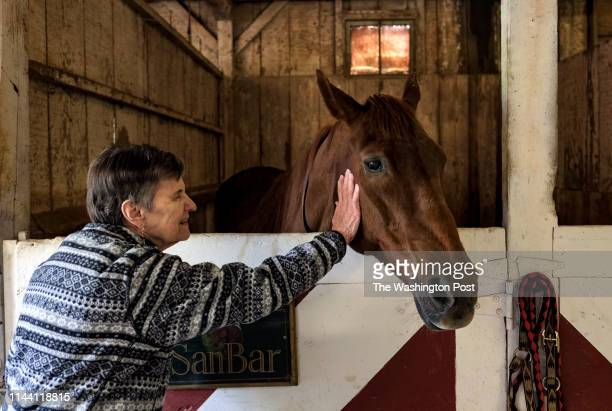 Bobbie Hess pets a horse during a visit at Notchcliff Farm in Glen Arm, MD on May 13, 2019. Hess was among residents at neighboring Glen Meadows...