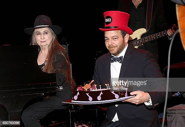 Bobbie Nelson gets a birthday cake delivered to her by Emcee Andy Langer to celebrate her 86th birthday on Jan 1st as she performs in concert with...