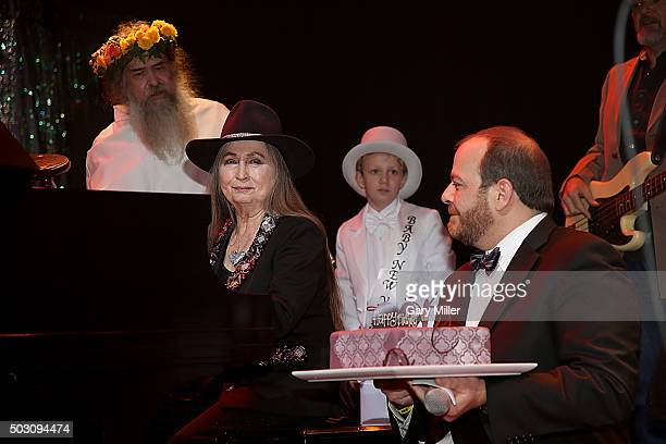 Bobbie Nelson is given a cake by Andy Langer as she celebrates her 85th birthday playing with her brother Willie Nelson at ACL Live on December 31...