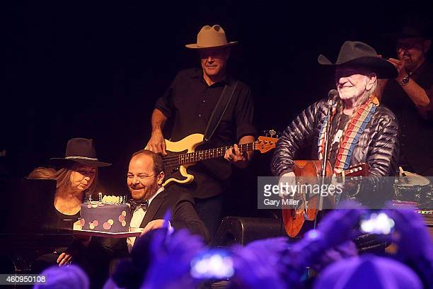 Bobbie Nelson is presented with a birthday cake as brother Willie Nelson performs in concert on New Years Eve at ACL Live on December 31 2014 in...