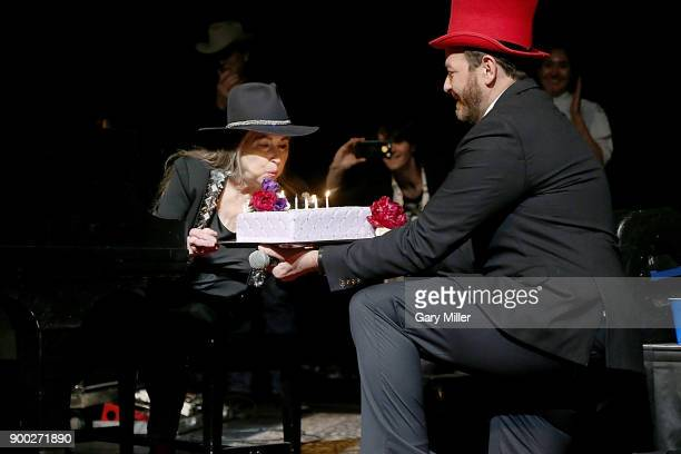 Bobbie Nelson is presented with a birthday cake by Andy Langer onstage before she performs with brothe Willie Nelson at ACL Live on December 31 2017...