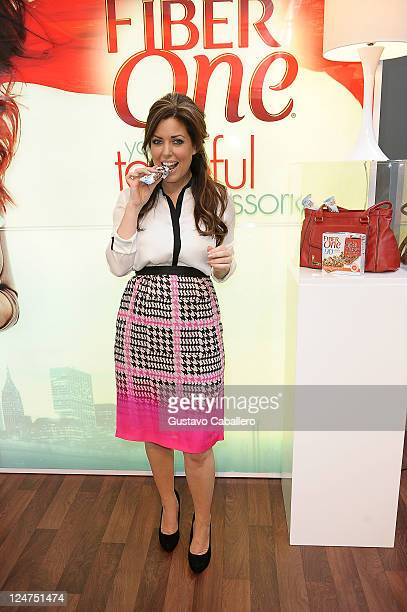 Bobbie Thomas poses with Fiber One Bars during Mercedes-Benz Fashion Week at Lincoln Center on September 12, 2011 in New York City.