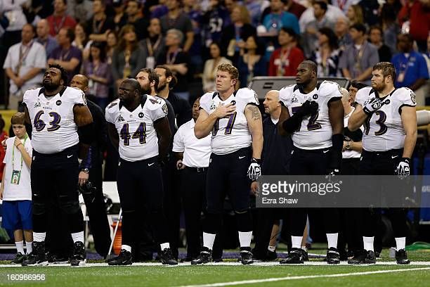 Bobbie Williams Vonta Leach Matt Birk Kelechi Osemele and Marshal Yanda of the Baltimore Ravens stand for the performance of the National Anthem...