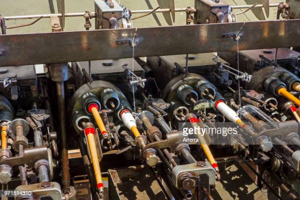 Bobbins with yarns on spool machine in cotton mill / spinningmill
