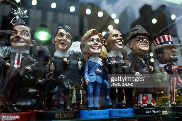 A bobble head doll of former Secretary of State and Democratic presidential hopeful Hillary Clinton is seen on a display with other figures at a...