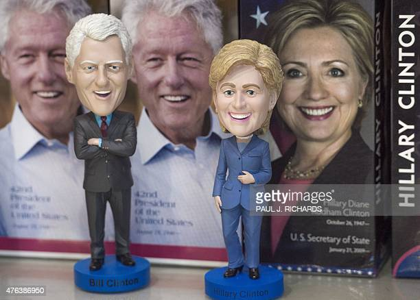 Bobble head dolls of former US President Bill Clinton and former Secretary of State and current Democrat Presidential hopeful Hillary Clinton are...