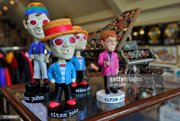 'Bobble head' figures of British singer Elton John are pictured at Gorringes auctioneers in Lewes southern England on October 19 2010 The figures...