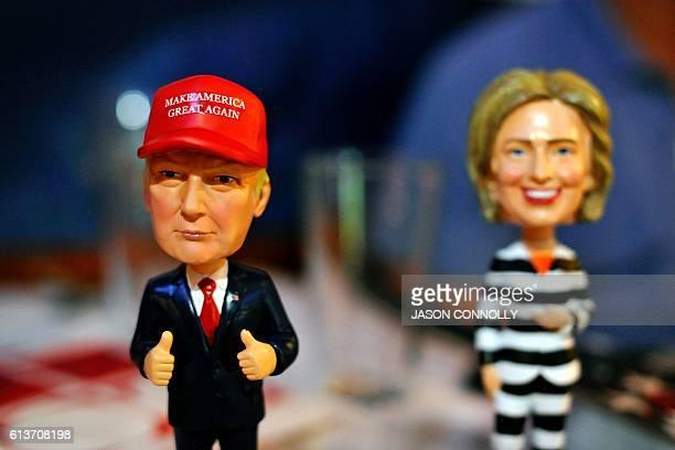 Bobble head figurines of Republican presidential nominee Donald Trump and Democratic presidential nominee Hillary Clinton greet Republican party...
