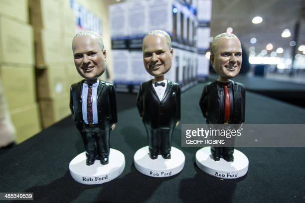 Bobblehead dolls of Toronto Mayor Rob Ford sit on a table as the mayor prepares to kick off his reelection campaign at a rally in Toronto on April 17...