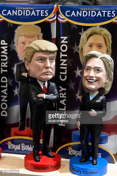 Bobblehead dolls of US Republican presidential nominee Donald Trump and Democratic presidential nominee Hillary Clinton are seen for sale in a gift...