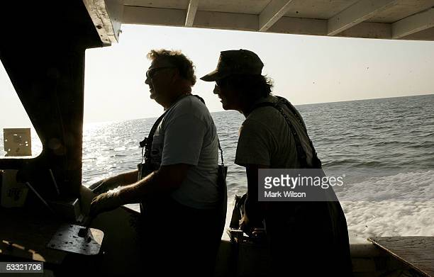Bobby Abner along with Donnie Eastridge aboard the commercial crabbing boat Foxy Roxy chat while traveling to their crab pots on the Chesapeake Bay...