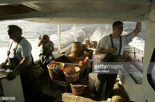 Bobby Abner along with Donnie Eastridge and Kevin Doane aboard the commercial crabbing boat Foxy Roxy travel to their crab pots on the Chesapeake Bay...