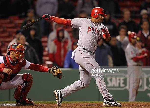 Bobby Abreu of the Los Angeles Angels of Anaheim hits a tworun single in the 11th inning against the Boston Red Sox at Fenway Park on May 4 2011 in...