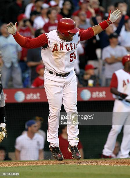 Bobby Abreu of the Los Angeles Angels of Anaheim reacts at home plate as he watches his walk off RBI single with two outs in the ninth inning against...