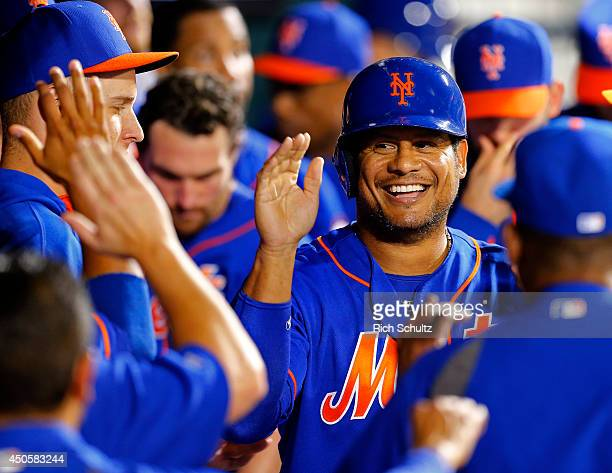 Bobby Abreu of the New York Mets is congratulated by teammates after scoring on a single by Taylor Teagarden during the second inning on June 13 2014...