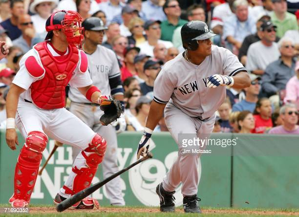 Bobby Abreu of the New York Yankees hits a RBI double in the sixth inning against the Boston Red Sox on August 21, 2006 at Fenway Park in Boston,...
