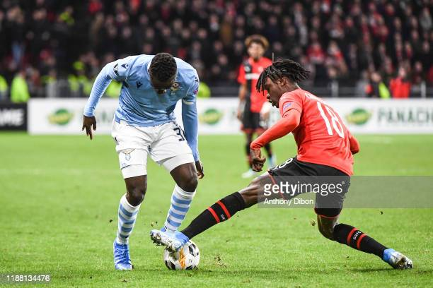 Bobby ADEKANYE of Lazio and Edouardo CAMAVINGA of Rennes during the Europa League match between Rennes and Lazio Rome at Roazhon Park on December 12...