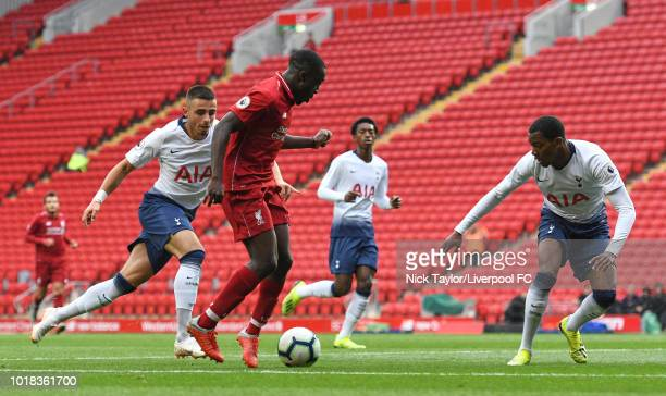 Bobby Adekanye of Liverpool and Anthony Georgiou and Jaden Brown of Tottenham Hotspur in action during the Liverpool v Tottenham Hotspur PL2 game at...