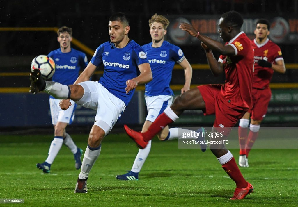 Bobby Adekanye of Liverpool and Con Ouzounidis of Everton in action during the Everton v Liverpool PL2 game on April 16, 2018 in Southport, England.