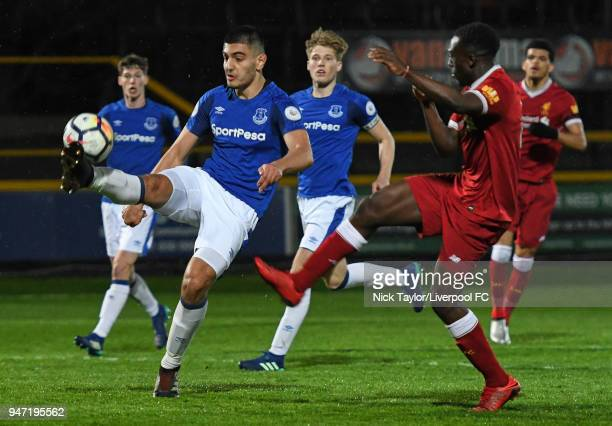 Bobby Adekanye of Liverpool and Con Ouzounidis of Everton in action during the Everton v Liverpool PL2 game on April 16 2018 in Southport England