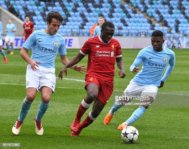Bobby Adekanye of Liverpool and Eric Garcia and Tom DeleBashiru of Manchester City in action during the Manchester City v Liverpool UEFA Youth League...