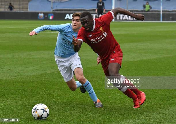 Bobby Adekanye of Liverpool and Iker Pozo of Manchester City in action during the Manchester City v Liverpool UEFA Youth League game at Manchester...