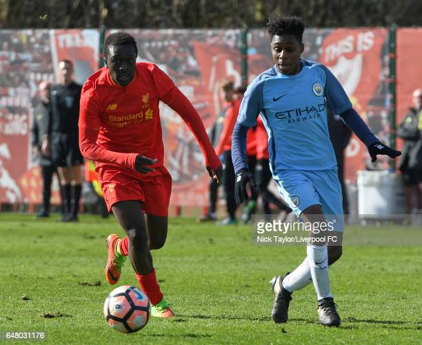 Bobby Adekanye of Liverpool and Jeremie Frimpong of Manchester City in action during the Liverpool v Manchester City U18 Premier League game at The...