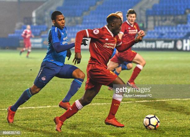 Bobby Adekanye of Liverpool and Jurich Carolina of PSV Eindhoven in action during the Liverpool v PSV Eindhoven Premier League International Cup game...