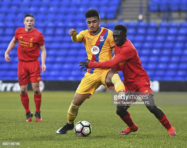 Bobby Adekanye of Liverpool and Kian Flannagan of Crystal Palace in action during the FA Youth Cup 3rd Round game at Prenton Park on December 17 2016...