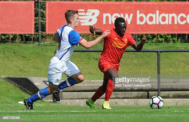 Bobby Adekanye of Liverpool and Lewis Thompson of Blackburn Rovers in action during the Liverpool v Blackburn U18 game at the Kirkby Academy on...