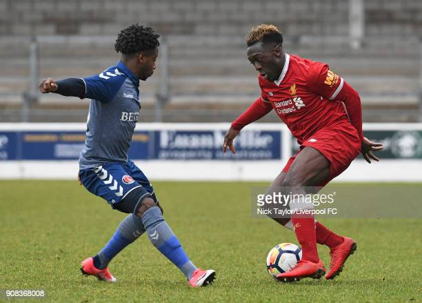 Bobby Adekanye of Liverpool and LouisMichael Yamfam of Charlton Athletic in action during the Liverpool U23 v Charlton Athletic U23 Premier League...