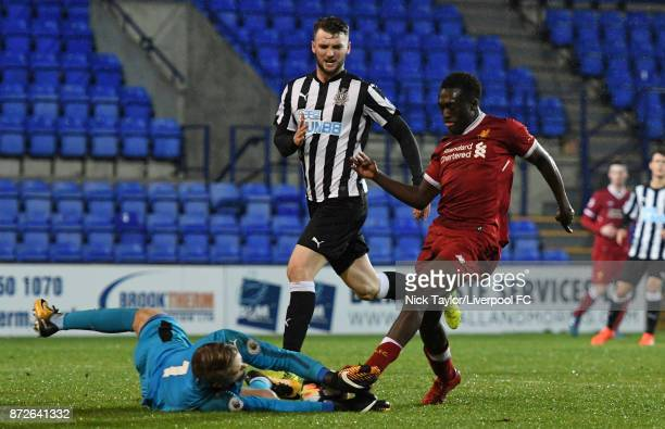 Bobby Adekanye of Liverpool and Nathan Harker of Newcastle United in action during the Premier League International Cup match between Liverpool U23...