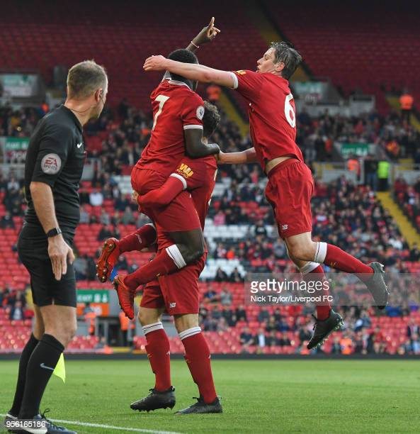 Bobby Adekanye of Liverpool celebrates scoring Liverpool's second goal with team mates Corey Whelan and Liam Coyle during the Premier League 2 match...