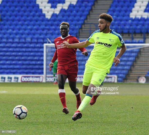 Bobby Adekanye of Liverpool competes with Jayden Bogle of Derby County during a Premier League 2 match between Liverpool and Derby County at Prenton...