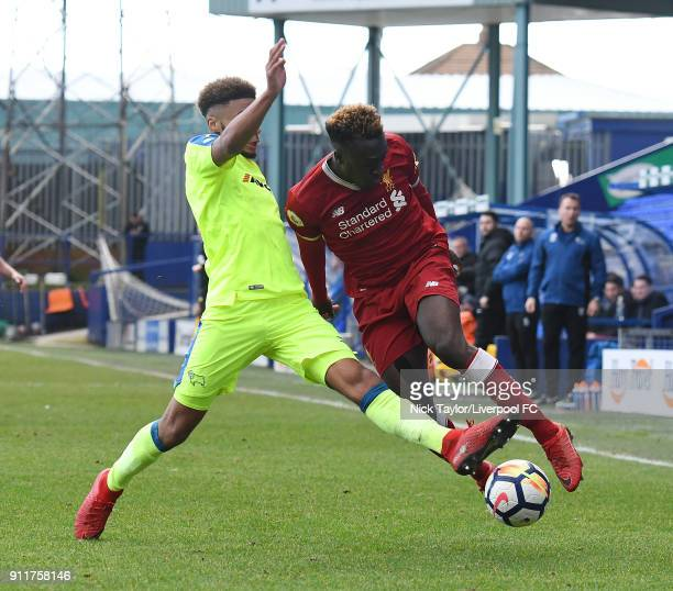 Bobby Adekanye of Liverpool competes with Jayden Bogle of Derby County during the Premier League 2 match between Liverpool and Derby County at...